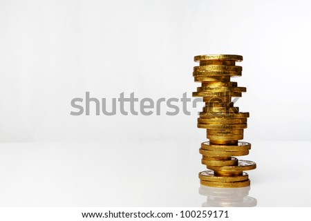 chocolate money coins on white background