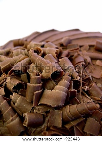 chocolate mousse cake with spiral chocolate shavings on top closeup