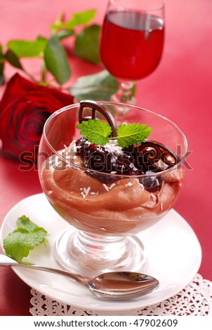 chocolate mousse dessert with black currant confiture in glass