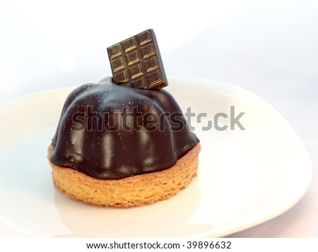 Chocolate mousse on a plate with candy bar garnish - stock photo