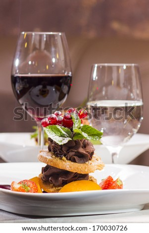 chocolate mousse with hazelnut - peach biscuits and berry sauce