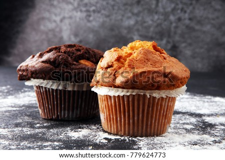 Stock Photo Chocolate muffin and nut muffin, homemade bakery on dark background