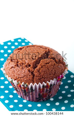 chocolate muffin cookie in a blue napkin - isolated