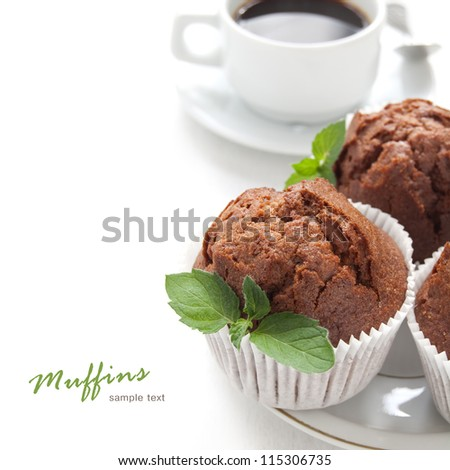 Chocolate muffin with fresh mint on the white background