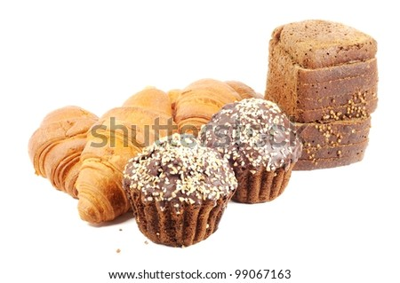 Chocolate muffin with nuts, croissants and brown bread  on white background
