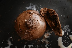 Chocolate muffin with nuts on dark background