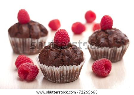 chocolate muffins with raspberry - stock photo