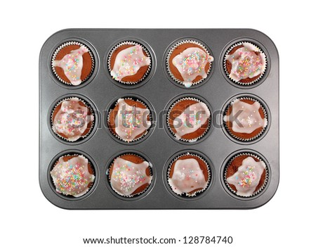 Chocolate Muffins with Sugar Icing. Isolated with clipping path.