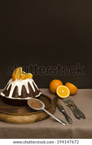 Chocolate orange cake covered with icing. Low key. From the series Cooking orange dessert
