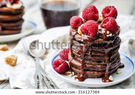 chocolate pancake with bananas, raspberies, nuts and chocolate sauce. the toning. selective focus