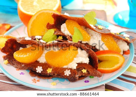 chocolate pancakes with cottage cheese,tangerines and star shape sprinkles as dessert for child