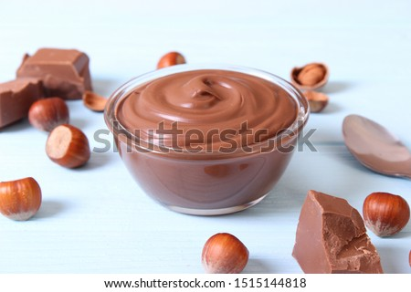 chocolate paste with a bowl on a table.