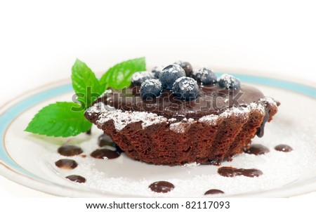 Chocolate pastry with bilberries on top