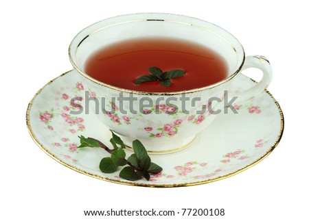 Chocolate peppermint tea in an antique tea cup isolated on a white background with clipping path.