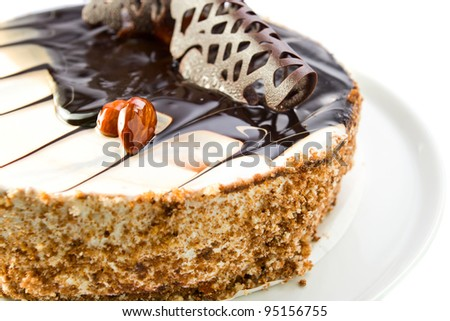 Chocolate pie with almonds,focus on a nuts,white background.