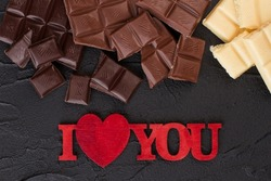 Chocolate pieces and inscription I love you.