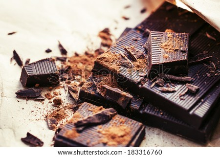 Chocolate pieces. Chopped dark chocolate closeup - stock photo