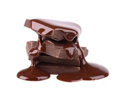 Chocolate pieces stack and chocolate syrup isolated on white background. Close up.