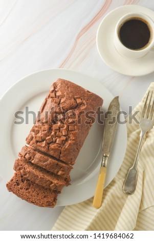 Chocolate pound cake. Homemade dark chocolate pastry for breakfast or dessert, light background