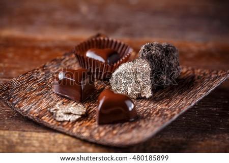 Chocolate praline with truffle on bamboo plate