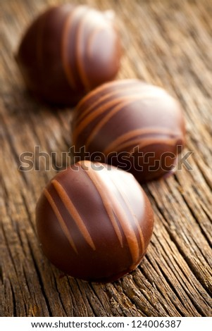 chocolate pralines on old wooden table