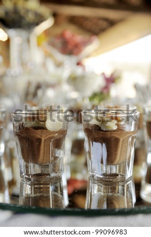 chocolate pudding with nuts, in small glasses
