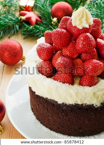 Chocolate Santa hat cake with strawberries and whipped cream. Shallow dof.