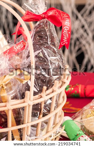 Chocolate Santa in a wicker gift basket close up