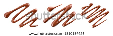 Chocolate sauce set isolated. Chocolate swirl on white top view. Chocolate syrup abstract pattern flat lay.