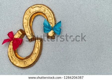 Chocolate shaped as horseshoe #1286206387