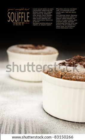 Chocolate souffle with chocolate chips and copyspace isolated on black background
