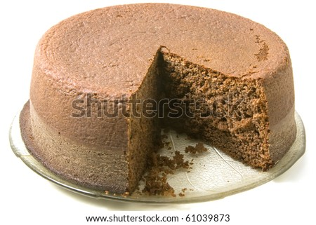 Chocolate sponge cake on a plate on white background
