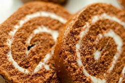 Chocolate sponge roll with a vanilla flavour filling, chocolate swiss roll, swirled cake