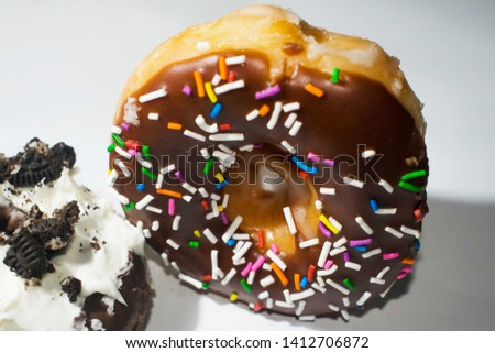 Chocolate sprinkled doughnut isolated on a white background
