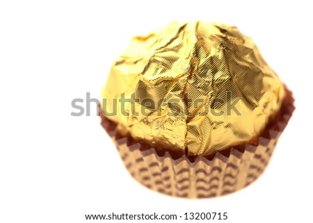 chocolate sweet on golden foil wrapping