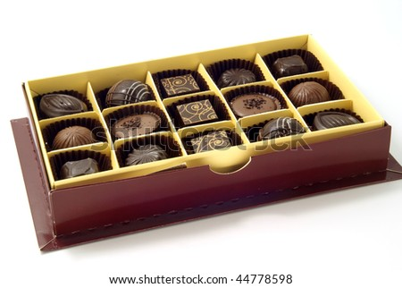 chocolate sweets in the box on white background