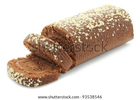 Chocolate Swiss roll closeup on a white background