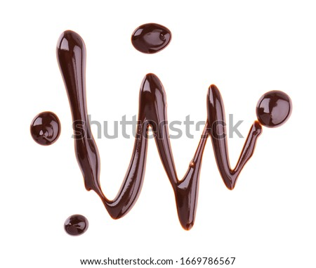 Chocolate syrup drizzle isolated on white background. Splashes of sweet chocolate sauce. Top view. Foto d'archivio ©