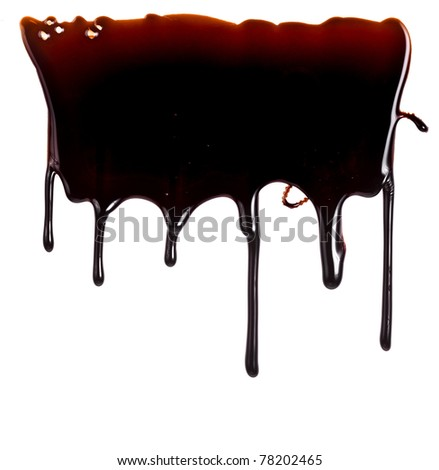 chocolate syrup leaking close up isolated on white background
