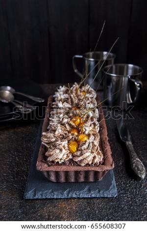 Chocolate tart with meringue and hazelnut.