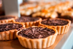 Chocolate tarts on a wooden board