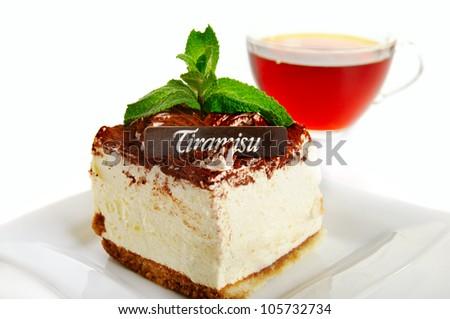 Chocolate tiramisu cake  on the  white with cup of tea