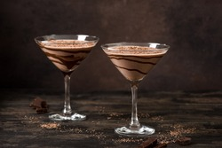 Chocolate Truffle Martini Cocktail on dark wooden background, copy space. Mudslide Truffletini cocktail recipe.