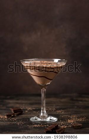 Chocolate Truffle Martini Cocktail on dark wooden background, copy space. Mudslide Truffletini cocktail recipe. Foto stock ©