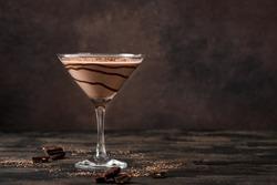 Chocolate Truffle Martini Cocktail on dark wooden background, copy space. Truffletini cocktail recipe.