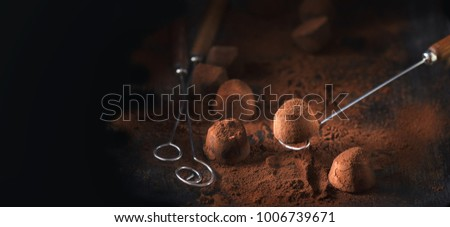 Chocolate truffles. Homemade fresh truffle dark chocolate candies with cocoa powder made by chocolatier. Gourmet food, delicious dessert. Wide angle