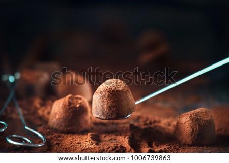 Chocolate truffles. Homemade fresh truffle dark chocolate candies with cocoa powder made by chocolatier. Gourmet food, delicious dessert