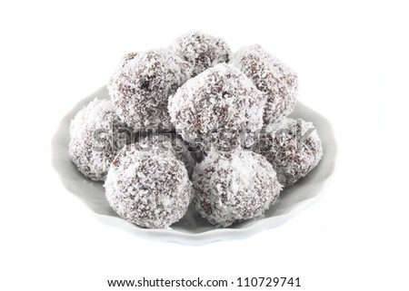 Chocolate truffles in coconut chips
