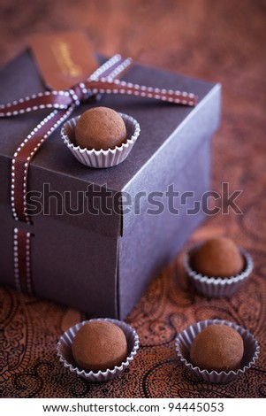 Chocolate truffles in gift box, selective focus - stock photo