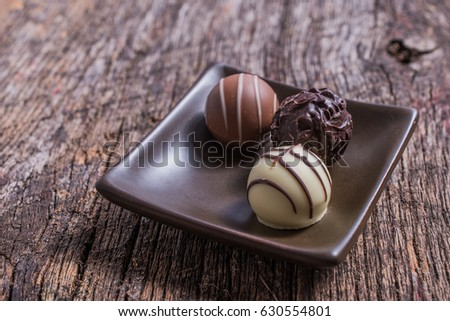 Chocolate truffles on wood table #630554801